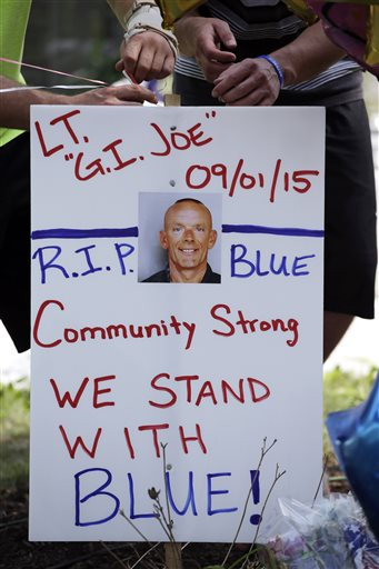 Residents show their support outside the Fox Lake Police department as the manhunt continued for three suspects thought to be the murderers of Gliniewicz. (AP Photo/Nam Y. Huh)