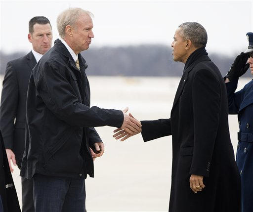 President Barack Obama is greeted by Illinois Gov. Bruce Rauner on the tarmac during his arrival on Air Force One at Abraham Lincoln Capitol Airport in Springfield, Ill., Wednesday, Feb. 10, 2016. Obama returned to Springfield, the place where his presidential career began, to mark the ninth anniversary of his entrance in the 2008 presidential race. He plans to deliver an address to the Illinois General Assembly at the Illinois State Capitol. (AP Photo/Pablo Martinez Monsivais)