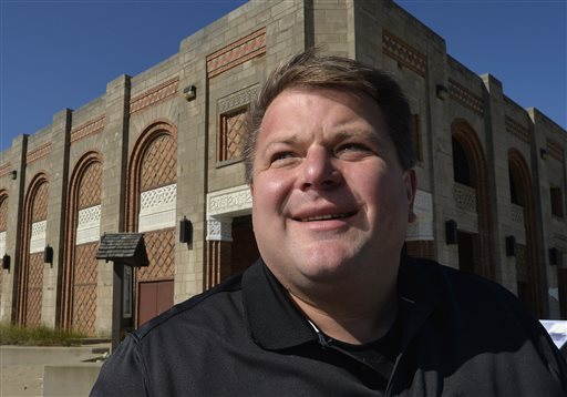In this Oct. 19, 2015 photo, developer Chuck Williams, a state Republican Party official, poses by the dilapidated beachfront pavilion at Indiana Dunes State Park in Chesterton, Ind., that he plans to rehabilitate. Williams says he's not backing away from his proposed banquet center at the Indiana Dunes State Park despite heavy opposition. (AP Photo/Paul Beaty)