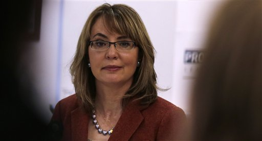 Former U.S. Rep. Gabby Giffords was severely wounded in a 2011 shooting that killed six in Tucson. She pushes for raising awareness around the issue of gun violence against women on state and federal levels. (AP Photo/Charles Krupa)