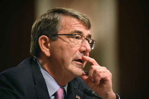 Defense Secretary Ash Carter testifies on Capitol Hill in Washington, Tuesday, Oct. 27, 2015, before the Senate Armed Services Committee. Carter said Tuesday that the U.S. is willing to step up unilateral attacks against Islamic State militants in Iraq or Syria, a signal that the U.S. would escalate American involvement beyond airstrikes by giving the go-ahead for U.S. special operations forces' raids on the ground. (AP Photo/Kevin Wolf)