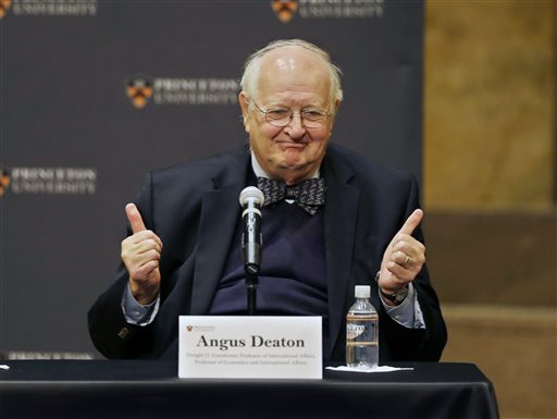 Angus Deaton gestures at a gathering at Princeton University after it was announced that he won the Nobel prize in economics for improving understanding of poverty and how people in poor countries respond to changes in economic policy Monday, Oct. 12, 2015, in Princeton, N.J. Deaton, 69, won the 8 million Swedish kronor (about $975,000) prize from the Royal Swedish Academy of Sciences for work that the award committee said has had