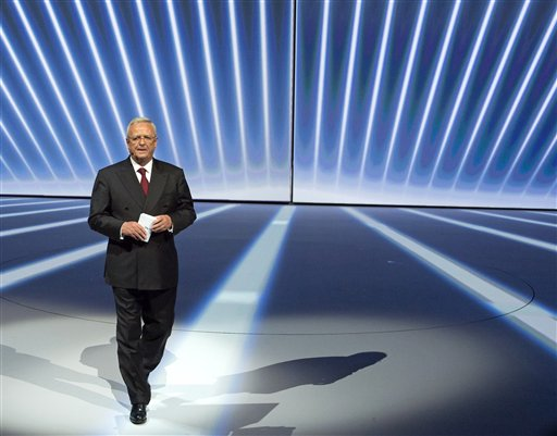 In this Sept. 14, 2015 photo Volkswagen CEO Martin Winterkorn, center, leaves the stage during the Volkswagen group night on the eve of the Frankfurt Auto Show IAA in Frankfurt, Germany. Volkswagen CEO Martin Winterkorn said Wednesday, Sept. 23, 2015 he is stepping down. (AP Photo/Jens Meyer)