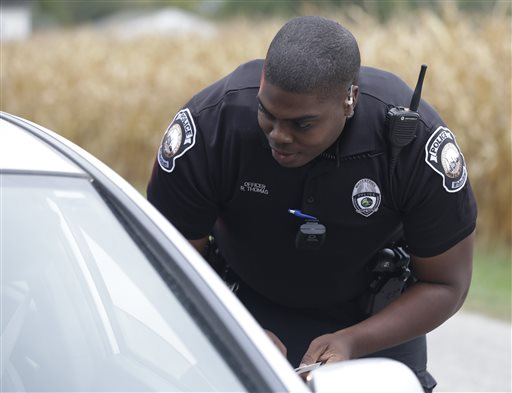 Whitestown Police Department officer Reggie Thomas makes a traffic stop, Tuesday, Sept. 29, 2015 in Whitestown, Ind. (AP Photo/Darron Cummings)