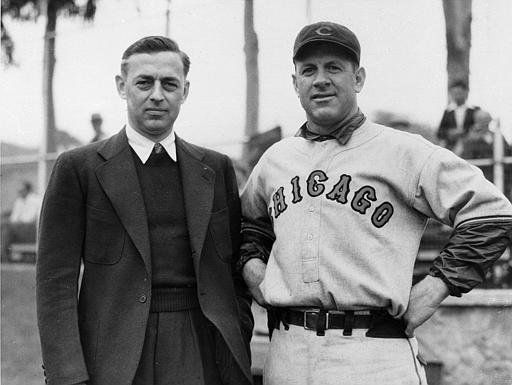 Philip K. Wrigley, left, poses with Charles Grimm at the Chicago Cubs training camp on Catalina Island, California in 1934. (AP Photo)