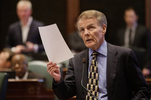 Illinois Speaker of the House Michael Madigan, D-Chicago, speaks to lawmakers while on the House floor during session at the Illinois State Capitol Tuesday, Oct. 20, 2015, in Springfield, Ill. Democrats in the General Assembly continue attempts at flanking the Republican governor on the budget impasse, advancing legislation that would distribute money that's already been collected to local governments, lottery winners and more. (AP Photo/Seth Perlman)