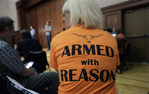 In this Wednesday, Sept. 30, 2015, file photo, professor Ann Cvetkovich waits to speak during a public forum as a special committee studies how to implement a new law allowing students with concealed weapons permits to carry firearms into class and other campus buildings, which will take effect in August 2016, in Austin, Texas. Despite a federal law requiring them to have detailed emergency plans, colleges across the country vary widely in how they prepare for campus shootings and inform their staffs and students. (AP Photo/Eric Gay)