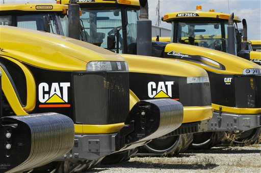 Tractors and equipment made by Peoria, Ill.-based Caterpillar Inc. are seen in Clinton, Ill. (AP Photo/Seth Perlman, File)