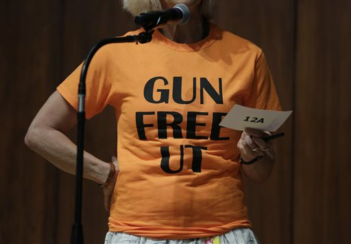 Professor Ann Cvetkovich speaks during a public forum as a special committee studies how to implement a new law allowing students with concealed weapons permits to carry firearms into class and other campus buildings, Wednesday, Sept. 30, 2015, in Austin, Texas. The law takes effect in August 2016. (AP Photo/Eric Gay)
