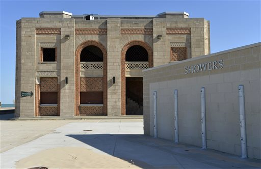 This Oct. 19, 2015 photo shows new showers built outside the historic pavilion at Indiana Dunes State Park in Chesterton, Ind. Developer Chuck Williams, who plans to rehabilitate the building, is warning that Indiana could owe him millions of dollars if officials scuttle his contract to bring fine dining, a banquet hall and bar to a lakefront state park surrounded by the state's towering dunes. (AP Photo/Paul Beaty)