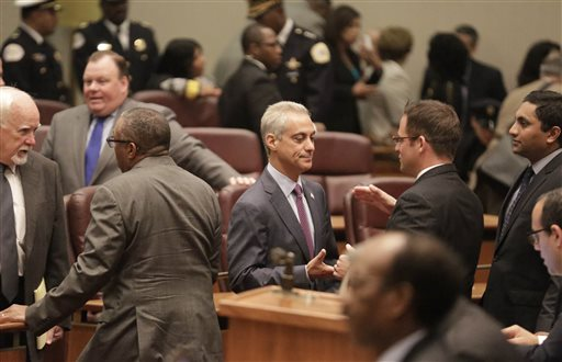 Mayor Rahm Emanuel, center, shakes hands in Council chambers before outlining his 2016 proposed budget to the City Council Tuesday, Sept. 22, 2015, in Chicago.  (AP Photo/M. Spencer Green)
