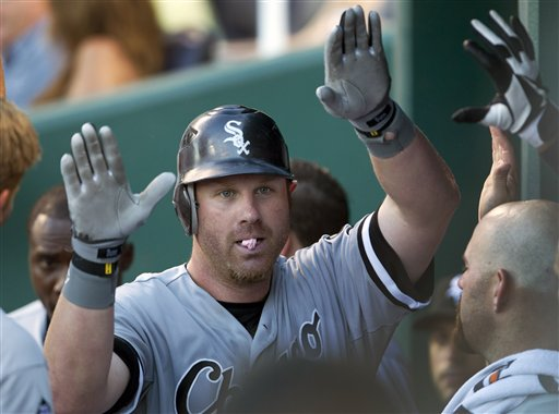 Teammates congratulate Adam Dunn after another home run. (AP/Orlin Wagner)