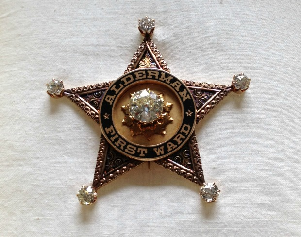 "A diamond-studded, gold star badge that was given to former first ward Alderman Michael ""Hinky Dink"" Kenna from a group of constituents. Museum officials say this is the perfect material representation of political corruption. (WBEZ/Lauren Chooljian)"