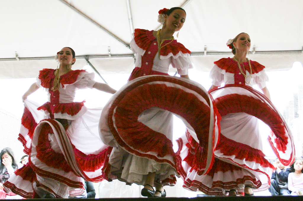 The Mexican Dance Ensemble performing a traditional Mexican folkloric dance. The dance is rich in tradition and involves coordinated feet movement along with twirling of the dresses. (Photo by Kate Gardiner)