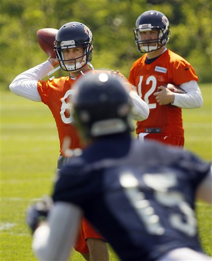 Bears Qb Jay Cutler throws to his favorite target Brandon Marshall. (AP Photo/Charles Rex Arbogast)