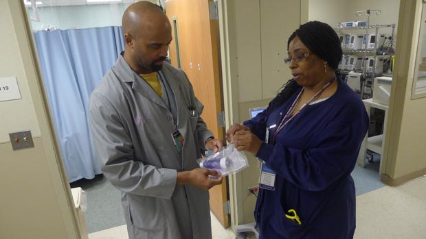 Dr. Max Gilles of Advocate Trinity Hospital handling an asthma breathing device with respiratory therapist Belinda Brown. (WBEZ/Michael Puente)
