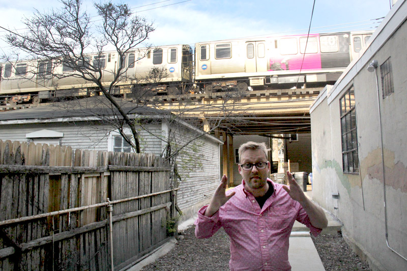 Collin Ashmead-Bobbitt pays $500 a month in rent, but his apartment backs up to the Red, Brown and Purple CTA lines. (WBEZ/Jesse Dukes)