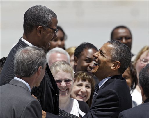 Warrenville Heights, Ohio mayor Brad Sellers greets President Obama at the Cleveland airport. (AP/Mark Duncan)
