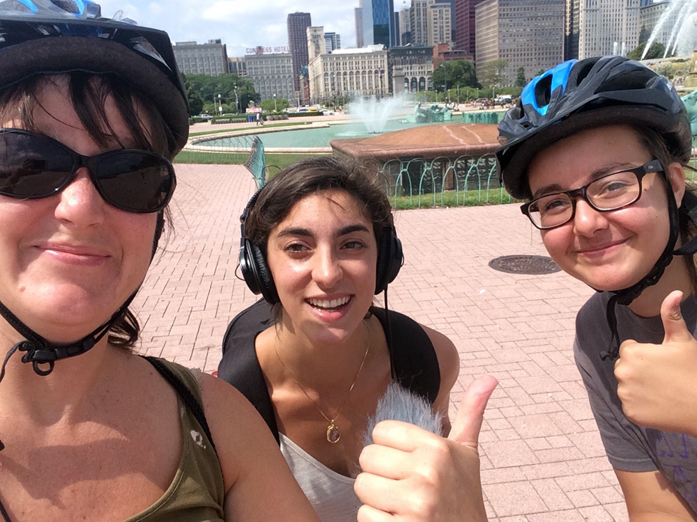Alison Troldahl, left, and daughter, Milayna Boswell, right, break from their segway tour to talk with producer Chloe Prasinos, center, about the fountain. They only asked for a selfie in return. (Courtesy of Alison Troldahl)