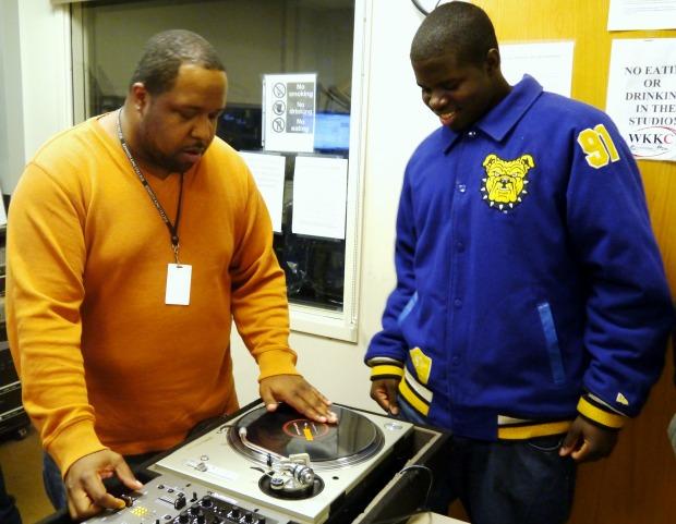 Jamar Houston of WKKC teaches Jermaine Robinson how to DJ. (WBEZ/Patrick Smith)