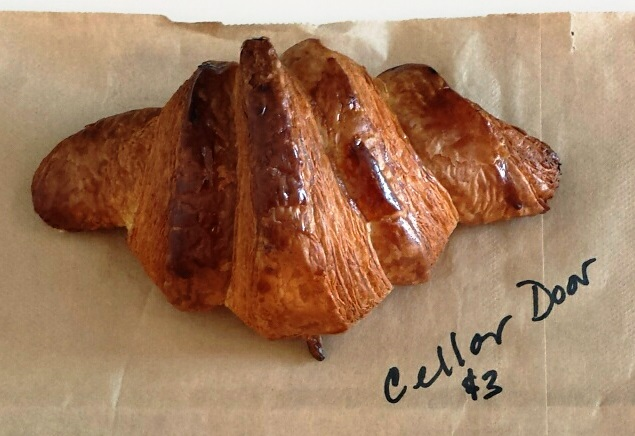 Cellar Door Provisions makes a croissant with an aggressively browned exterior and soft tender interior. (WBEZ/Monica Eng)
