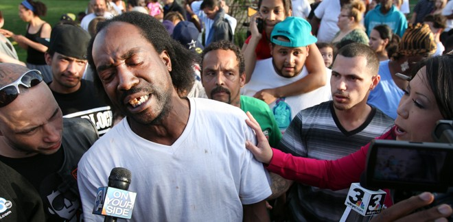 Charles Ramsey, being interviewed after saving the lives of Amanda Berry and two other Cleveland women. (AP)