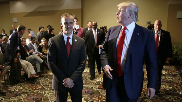 Republican presidential candidate Donald Trump with his campaign manager, Corey Lewandowski, in Iowa last year. (Charlie Nelbergalt/AP)