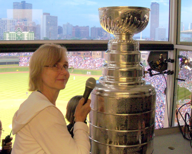Cheryl Raye-Stout interviews the Stanley Cup at Wrigley Field after the Blackhawks win in 2010. (Author's own)