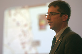 Brett Goldstein, the commissioner and chief data officer for the Department of Innovation and Technology, addresses a group of academics, developers and urban planners in February. Behind him, is a picture of a program dubbed WindyGrid.  (Lloyd DeGrane)