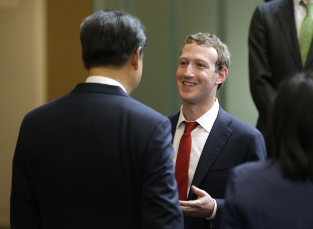 Chinese President Xi Jinping, left, talks with Facebook Chief Executive Mark Zuckerberg, right, during a gathering of CEOs and other executives at Microsoft's main campus September 23, 2015 in Redmond, Washington. (Ted S. Warren/Getty Images)