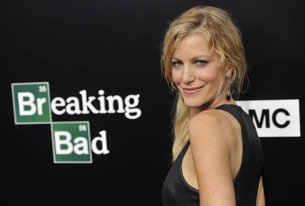 """Anna Gunn, who plays Skyler White on """"Breaking Bad,"""" poses at a premiere screening to celebrate the final episodes of the television series at Sony Pictures Studios on Wednesday, July 24, 2013 in Los Angeles. (AP/Chris Pizzello)"""