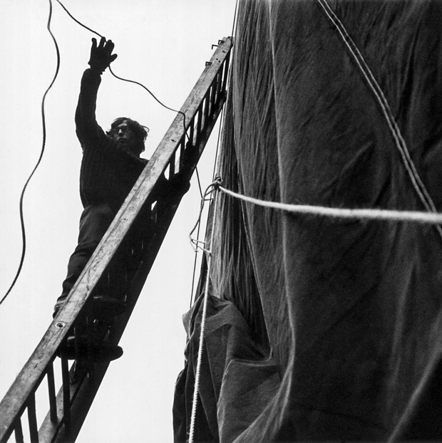 The artist Christo ties rope around the exterior of the Museum of Contemporary Art Chicago during the installation of his 1969 show 'Wrap In Wrap Out.' (Harry Shunk)