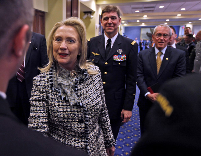 Secretary of State Hillary Rodham Clinton greets staff at NATO Allied Command Transformation headquarters in Norfolk, Va. in April. (AP/Steve Helber)