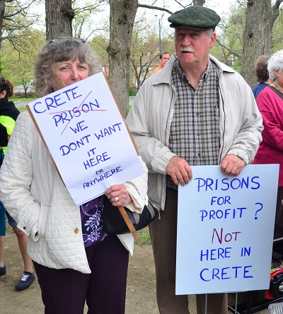 Village residents in April marched against the project, in which Corrections Corporation of America would have held detainees for U.S. Immigration and Customs Enforcement. (WBEZ/Charlie Billups)