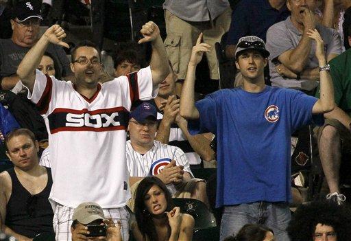Cubs-Sox fans. (AP/Charles Rex Arbogast)