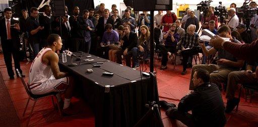 Derrick Rose addresses the media as camp begins. (AP Photo/Charles Cherney)
