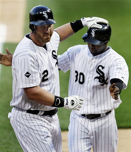Adam Dunn celebrates with Alejandro DeAza after hitting a 2-run homer against the Tigers on Monday. (AP/John Smierciak)