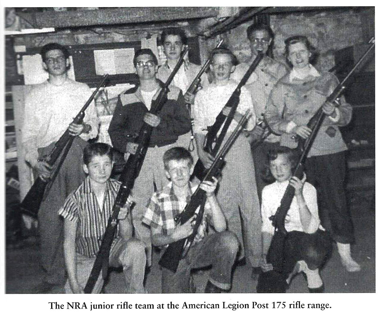 Gerry Souter, second from the left in the middle row, stands with his rifle team at an American Legion range in 1956. Souter says, at the time, rifle-shooting was considered a wholesome sport, but political polarization around guns changed that perception in the 1960s and 1970s. (Photo courtesy Gerry Souter, from his book 'The American Shooter: A Personal History of Gun Culture In The United States')