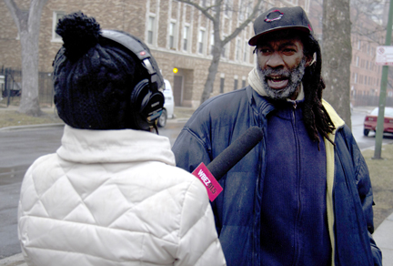 Natalie Moore interviews Lawrence Wilder, a landscaper and maintenance man who has lived on 74th Street and Coles Avenue. for most of his life. (WBEZ/Logan Jaffe)