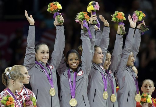 The 'Fab 5' women's gymnastics team has impressed many in Chicago, including our NFL players. (AP/Julie Jacobson)