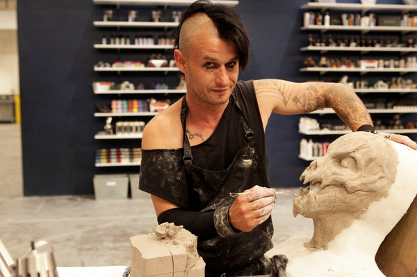 Eric F. works on a creature for the SyFy reality series