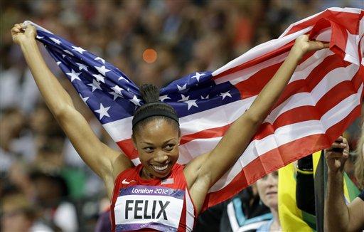 Allyson Felix captures the 200 meter race. (AP/Lee Jin Man)