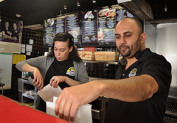"Amjad ""AJ"" Haj, who co-owns three Al's Beef franchises in Chicago, praises the company's support to run them. (WBEZ/Shannon Heffernan)"
