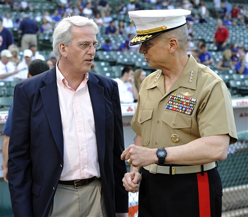 U.S. Marine Corp General John Allen and Ivo H. Daalder, U.S. representative to NATO, on the field for pre-game ceremonies on Saturday. (AP/Jim Prisching)