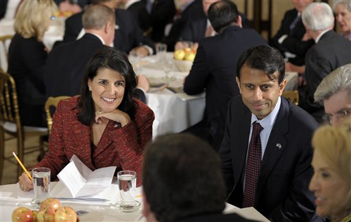 South Carolina Gov. Nikki Haley, left, and Louisiana Gov. Bobby Jindal at a meeting of the National Governors Association in February. (AP/Susan Walsh)