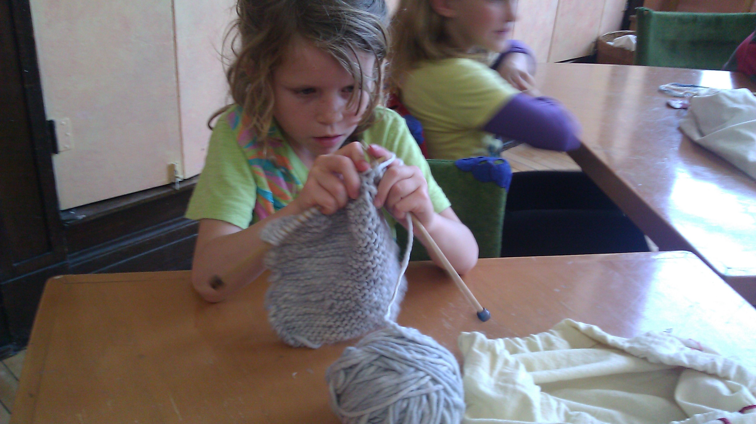 Apollonia Bingham-Bianco, at work on her first-grade knitting project: the hat. (Linda Lutton/Front and Center)