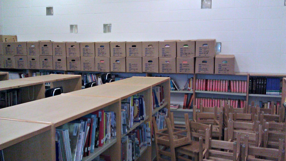 Boxes of books from shuttered Emmet Elementary in the DePriest school library.