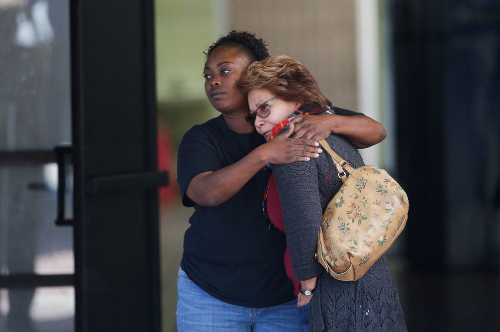 Two women embrace at a community center where family members have been gathering to pick up survivors after the shooting rampage at a social services center in San Bernardino, Calif. (AP/Jae C. Hong)