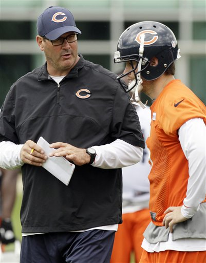 Jay Cutler and Mike Tice must be on the same page to ensure a good season. (AP Photo/ Nam Y. Huh)