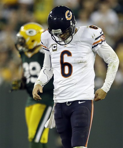 Jay Cutler beaten and battered in Green Bay.(AP Photo/Jeffrey Phelps)